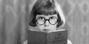 Masthead - Young Girl reading 'The Mind Arithmetics'