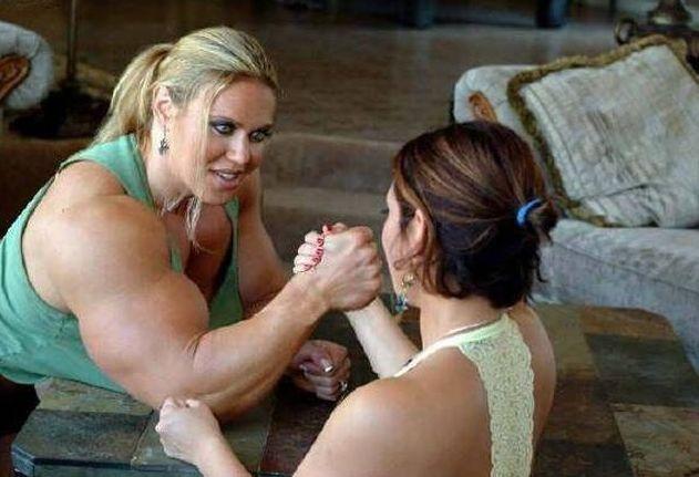 Two women arm wrestling
