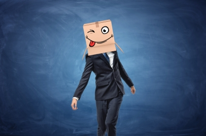 man in a suit with box on his head - Outsmarting the competition
