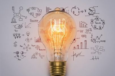 marketing strategy - lightbulb surrounded by charts and graphs