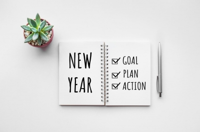 notebook with new year and goal, plan, action checklist