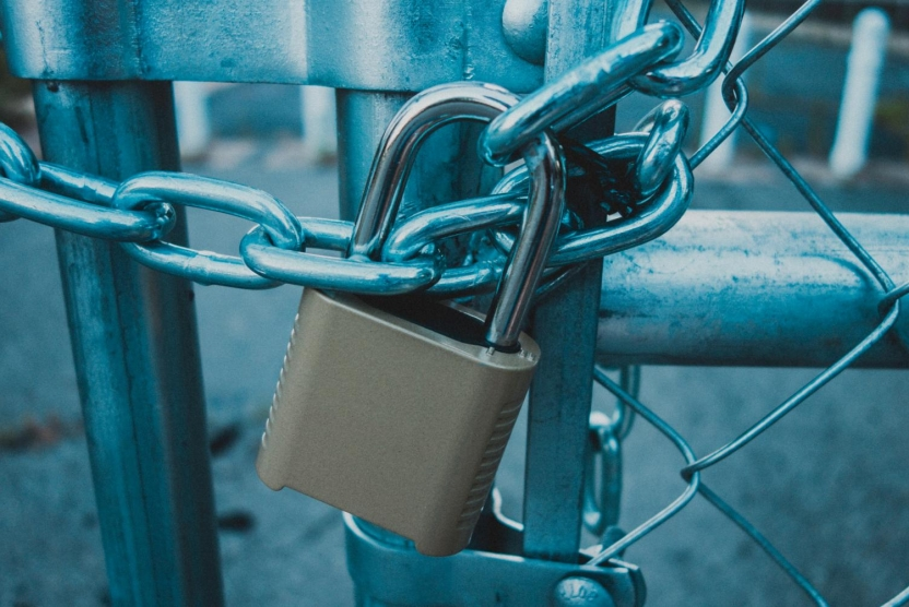 locked padlock and chain on a gate