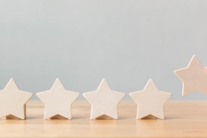 five wooden stars representing customer reviews
