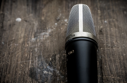 social listening concept - microphone on a wood table